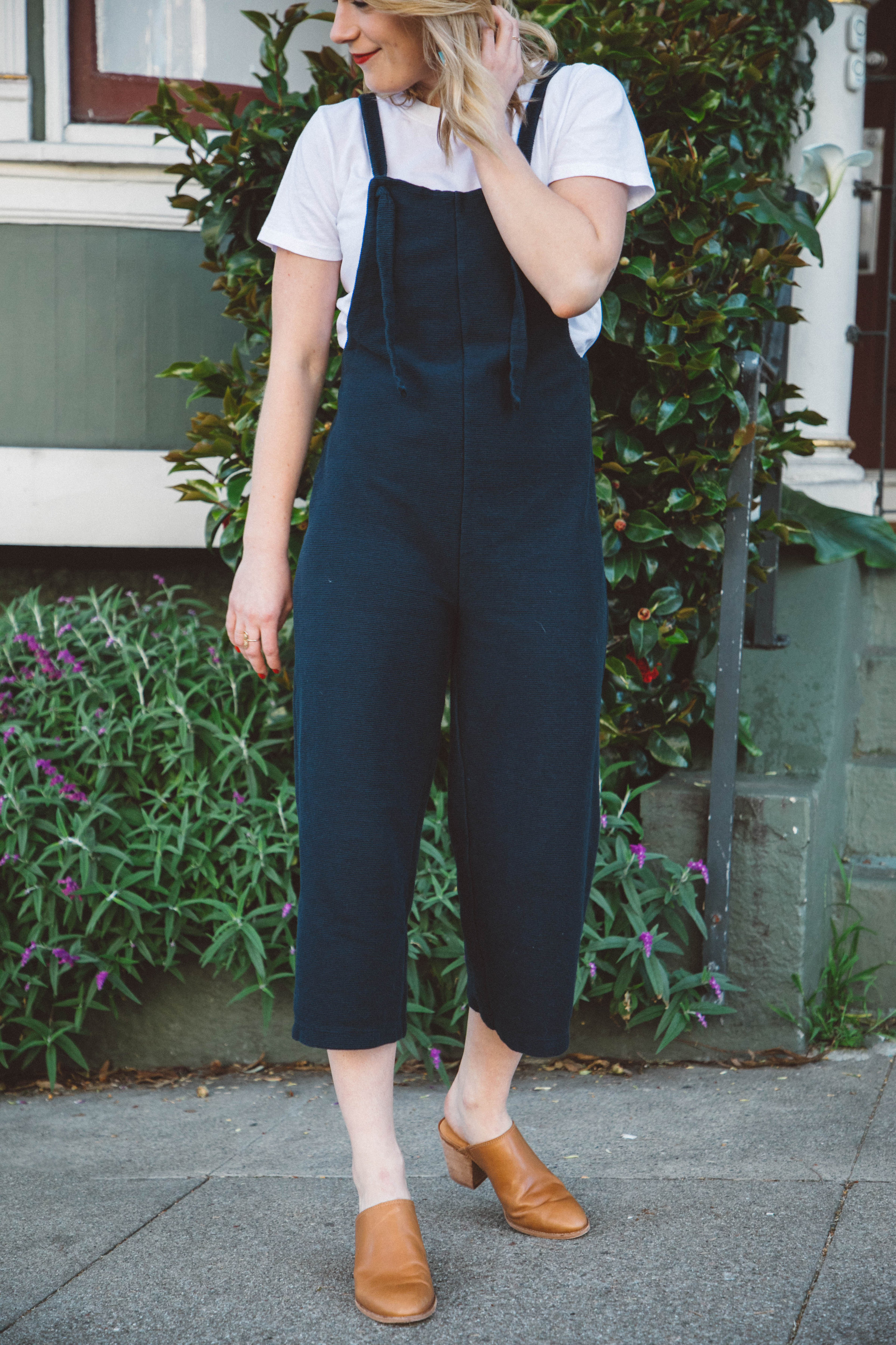 All About The Jumpsuit // A knit Madewell jumpsuit dresses up a classic Everlane white tee for an easy, everyday look.